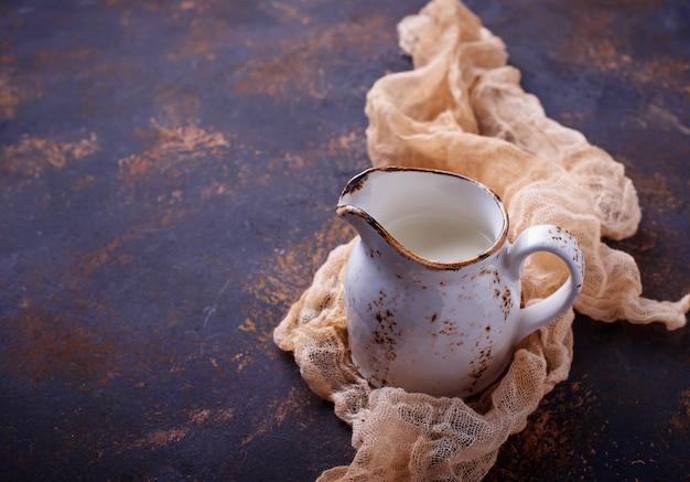 Fresh milk in a jug. top view