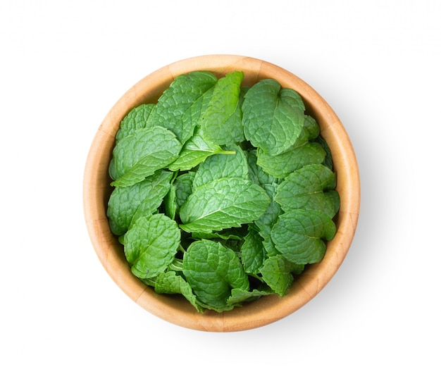 Fresh mint leaves pattern in wood bowl isolated