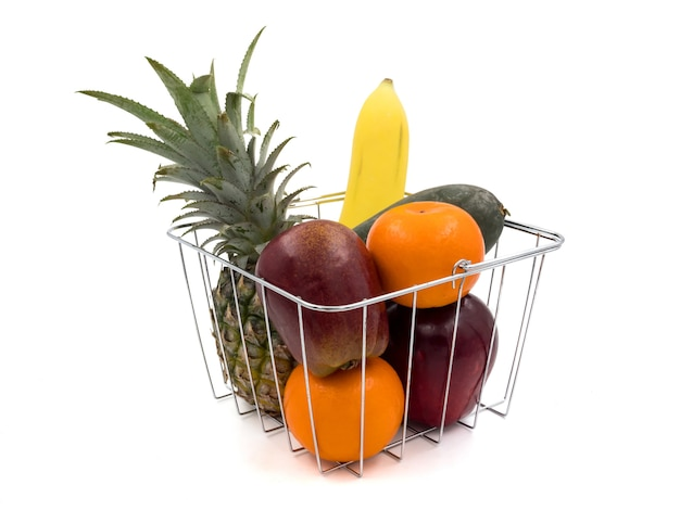 Fresh mixed fruits in basket on a white background