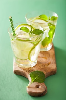 Fresh mojito cocktail over green table
