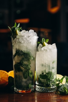 Fresh mojito in glasses on wooden table