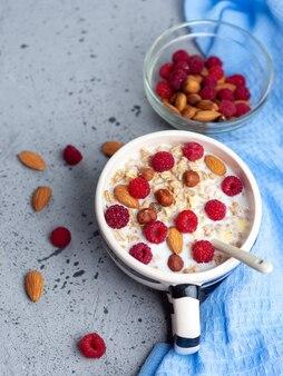 Fresh muesli with nuts and raspberries