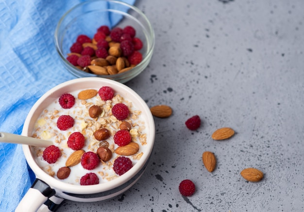 Fresh muesli with nuts and raspberries
