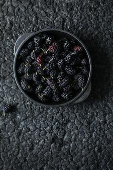 Fresh mulberries background. various summer black fruits.