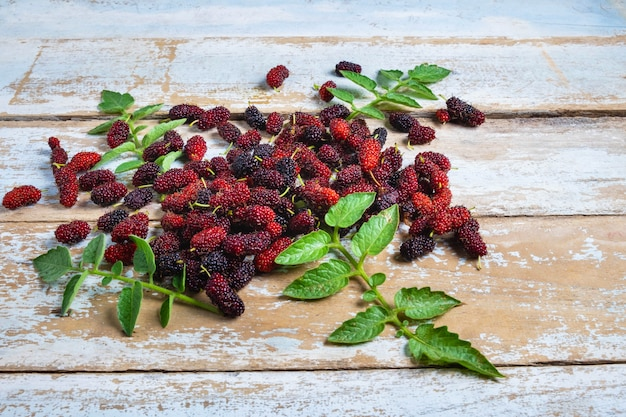Fresh mulberry on a wooden background