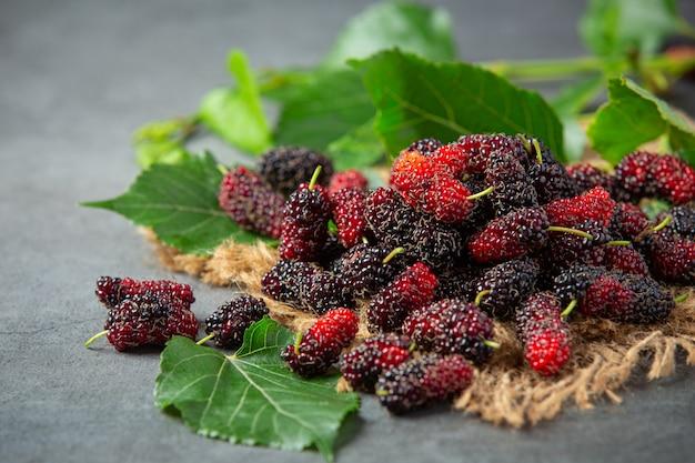 Fresh mulberrys on dark surface