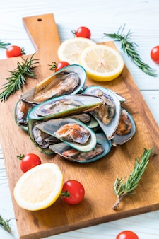 Fresh mussels on wooden board