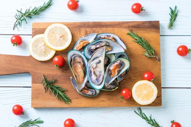 Fresh mussels on wooden board