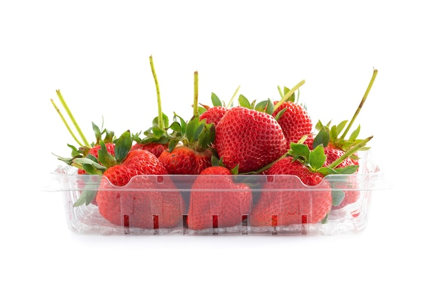 Fresh natural strawberry in plastic tray isolated on white background