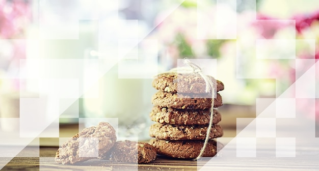Fresh oatmeal cookies with milk on a texture wood background. christmas gingerbread cookie and glass of milk.