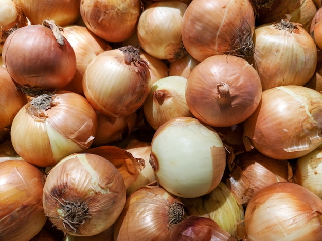 Fresh onions for sale in the market.