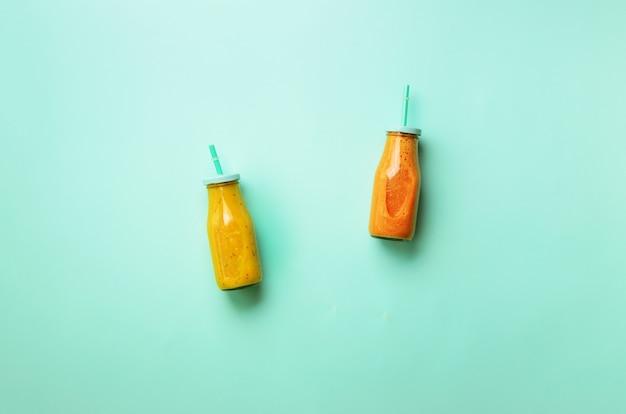 Fresh orange, banana, pineapple, mango smoothies and juicy fruits. detox summer drink. vegetarian concept.