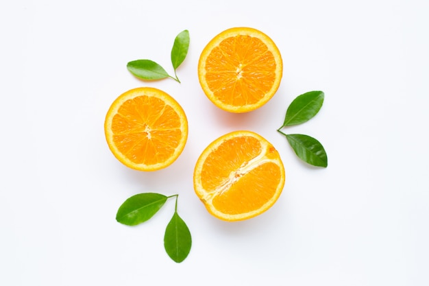 Fresh orange citrus fruit with leaves isolated on white background.
