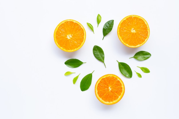 Fresh orange citrus fruit with leaves isolated on white surface.