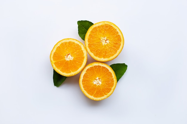 Fresh orange citrus fruit with leaves isolated on white wooden background.  top view
