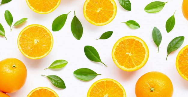 Fresh orange citrus fruit with leaves isolated on white.