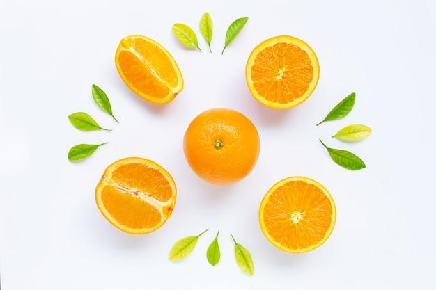 Fresh orange citrus fruit with leaves isolated