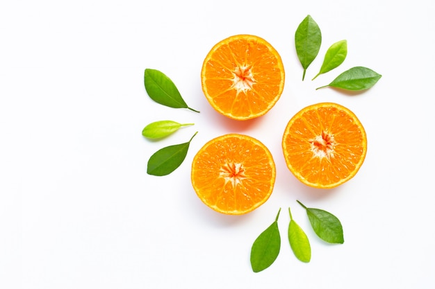 Fresh orange citrus fruit with leaves on white