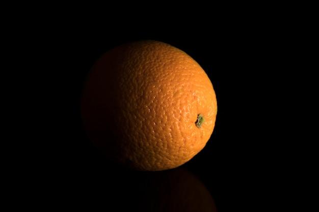 Fresh orange in the dark. low key concept.