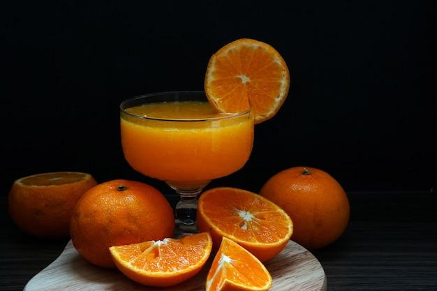 Fresh orange fruit make orange juice in a glass