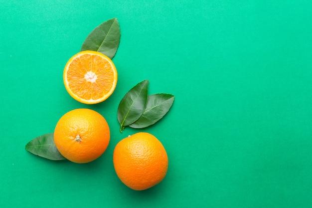 Fresh orange on green in top view