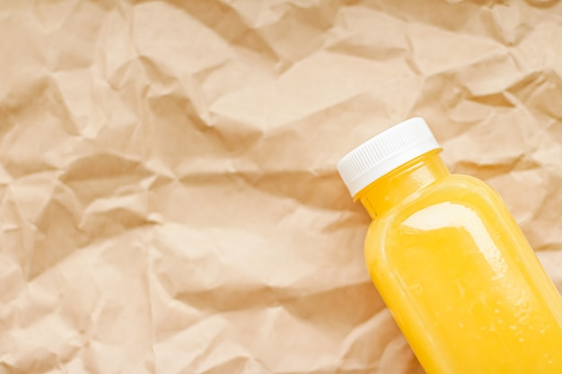 Fresh orange juice in ecofriendly recyclable plastic bottle and packaging healthy drink and food product concept
