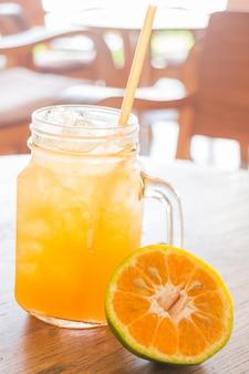 Fresh orange juice serving on wooden table