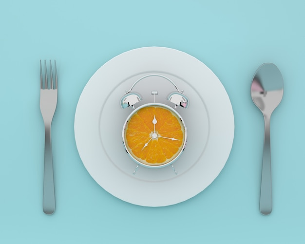 Fresh orange slice alarm clock on plate with spoons and forks on blue color. minimal conce