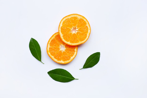 Fresh orange slices, citrus fruits with leaves on white background.