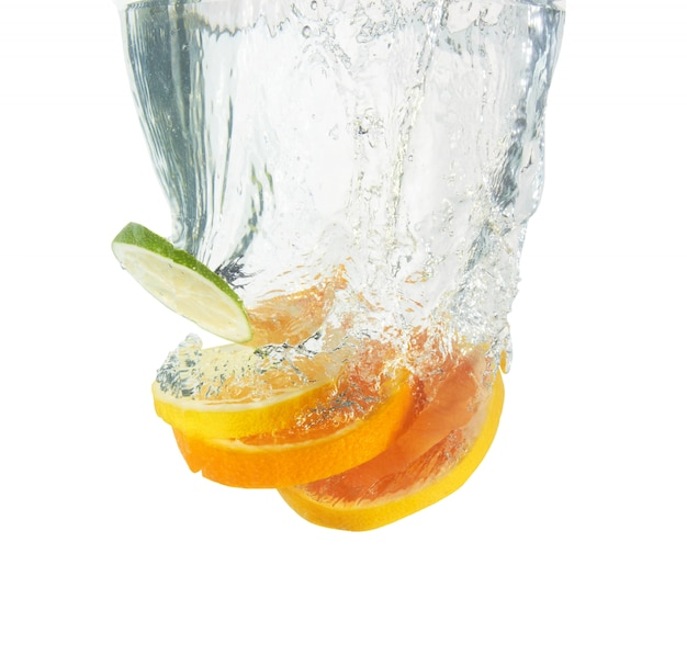 Fresh orange slices dropped into water