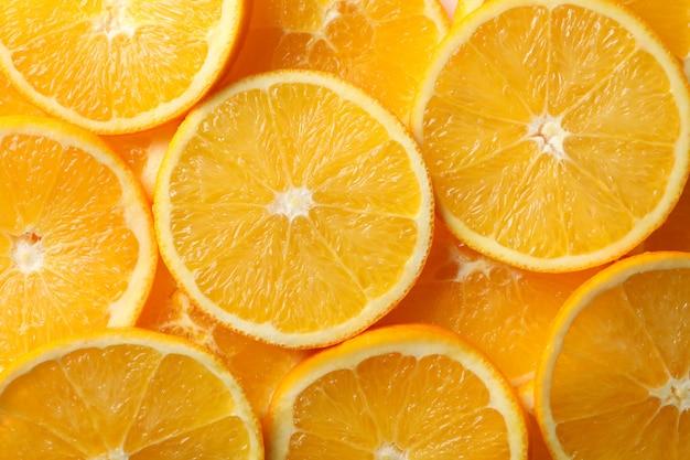 Свежие апельсиновые дольки текстуры фона, крупным планом