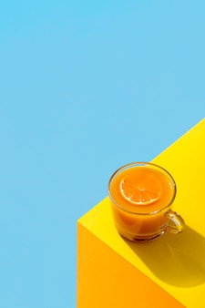Fresh orange smoothie on the corner of a table