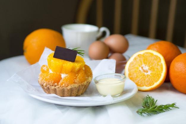 Fresh orange tart with ingredients