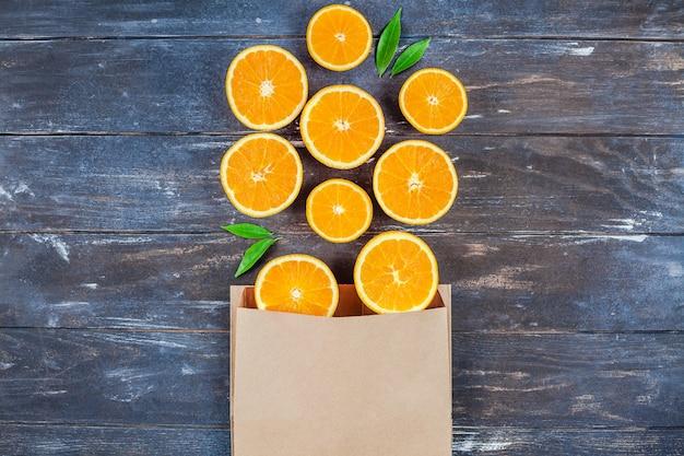 Fresh oranges on dark wooden table