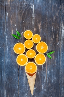 Fresh oranges on dark wooden table