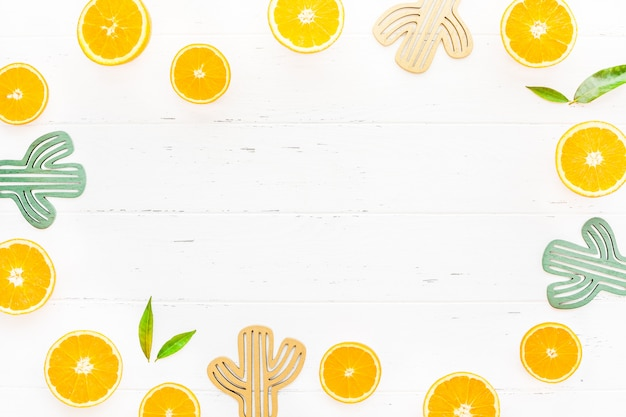 Fresh oranges frame on white background