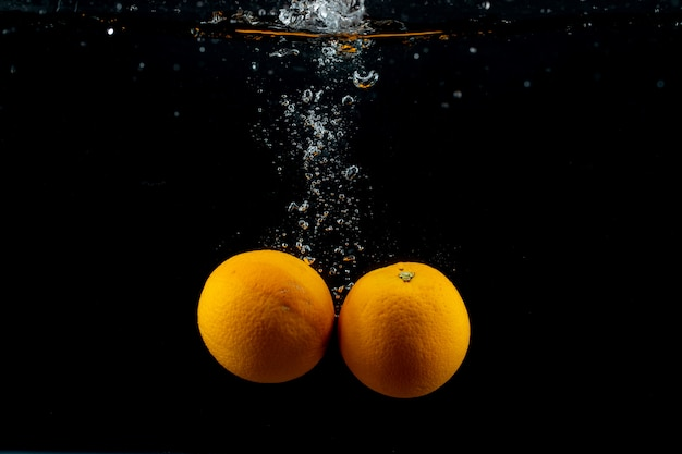 Fresh oranges in the water