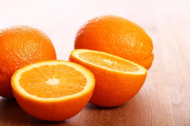 Fresh oranges on wooden board