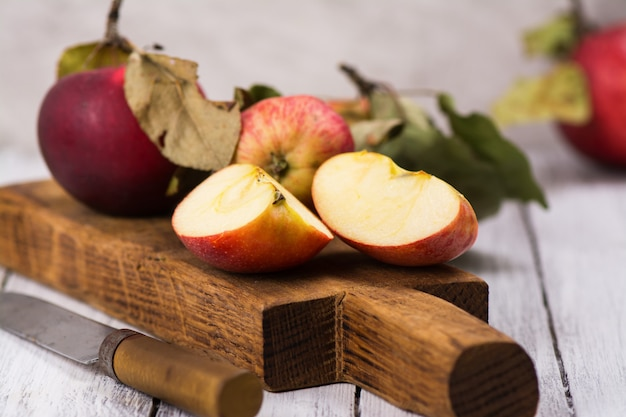 Fresh organic apples on wooden board