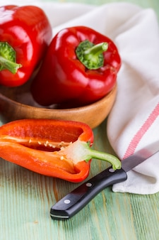 Fresh organic bell peppers on a wooden board