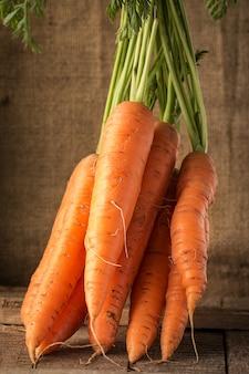 Fresh organic carrots  on wood
