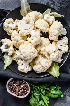 Fresh organic cauliflower cut into small pieces in bowl