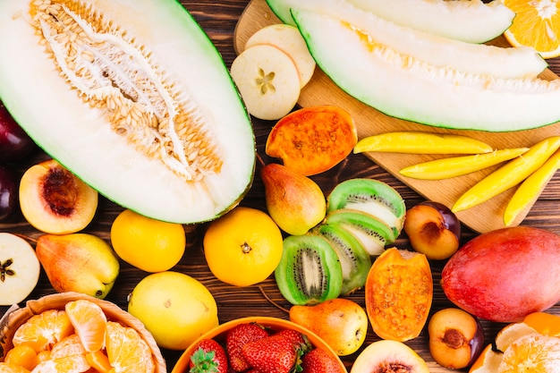 Fresh organic colorful fruits on wooden table