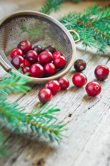 Fresh organic cranberries on a wooden