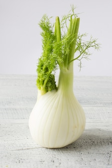 Fresh organic fennel on wooden white table