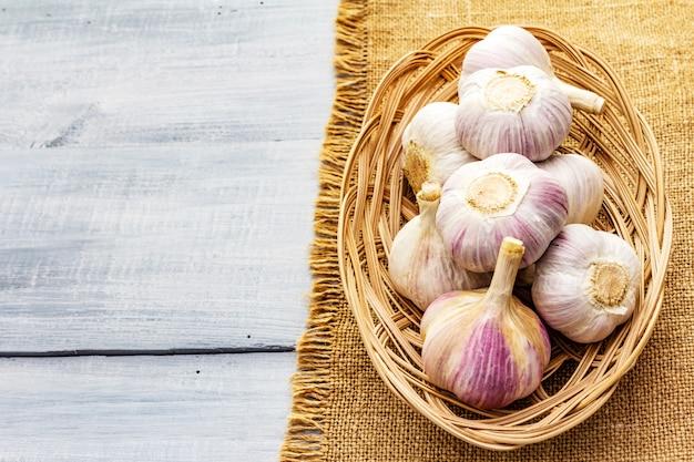 Fresh organic garlic on sackcloth