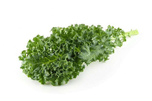 Fresh organic green kale leaves isolated