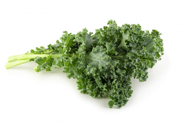 Fresh organic green kale leaves isolated
