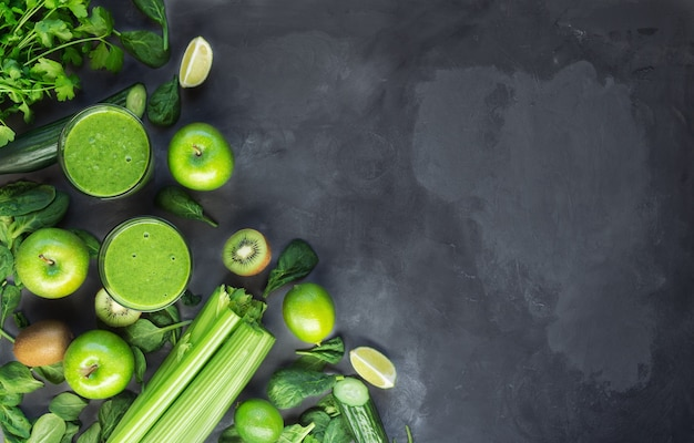 Fresh organic green smoothie with ingredients on gray concrete background. top view. copy space area.