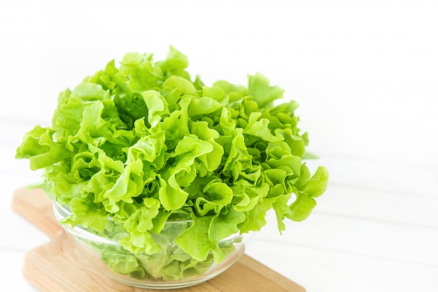 Fresh organic healthy green oak lettuce vegetable in a glass bowl